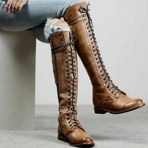 Artisan leather lace up tan boots.